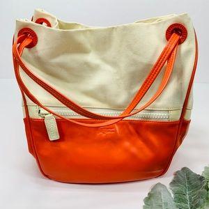 LACOSTE   Expandable Bucket Bag Magnetic Closure